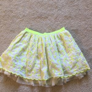 A white and neon yellow skirt